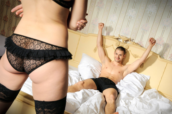 woman in lingere standing before her boyfriend