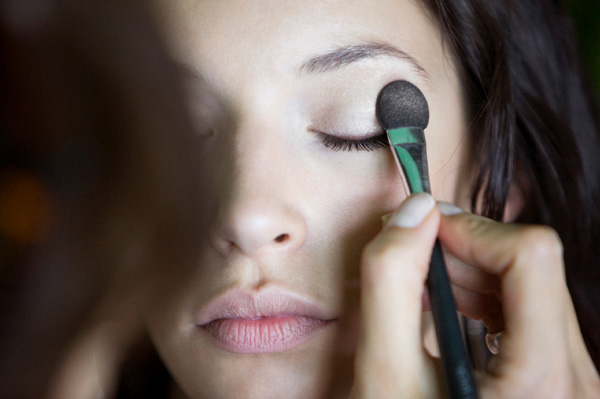 Makeup artist doing fall makeup