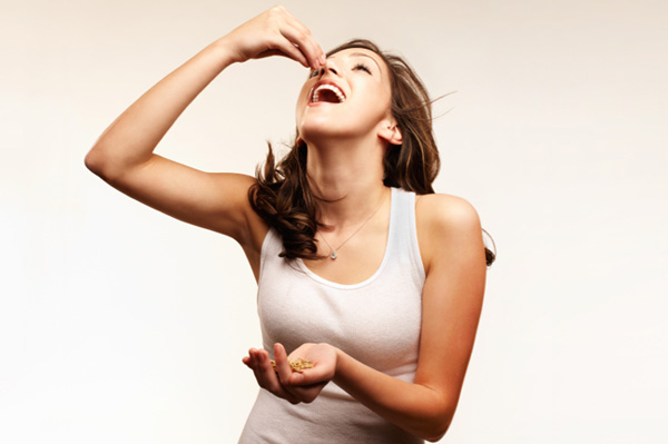 Sexy woman eating nuts