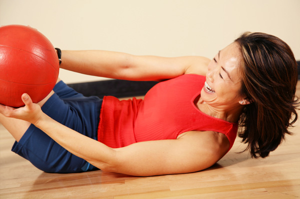 Woman with medicine ball