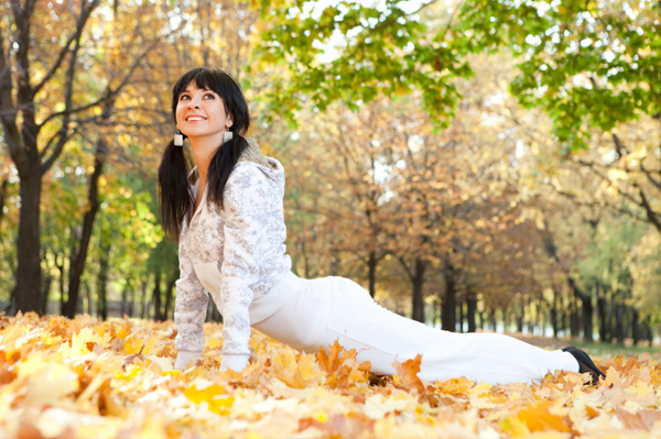 Woman doing stretches in the fall