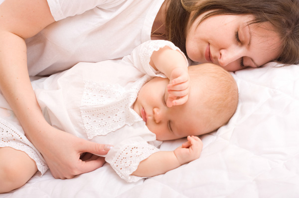 Woman napping with baby