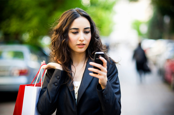 Woman running errands with smartphone