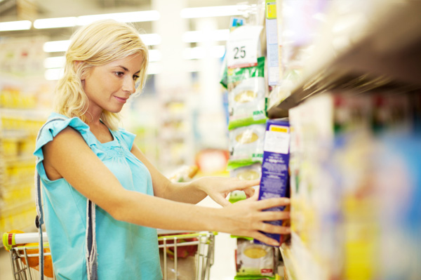 Woman shopping for healthy snacks