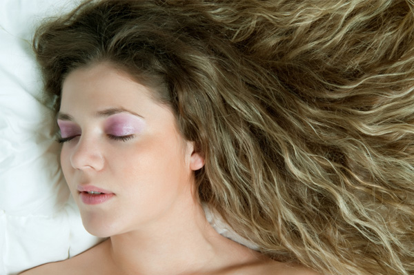 Woman sleeping while wearing makeup