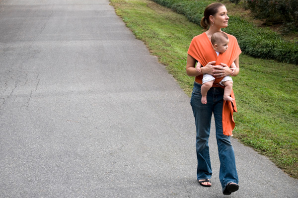 Woman walking with baby sling