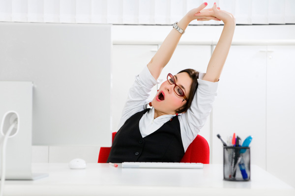 Woman yawning at work
