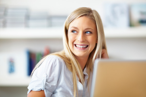 Young business woman on computer