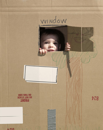 Boy with cardboard fort
