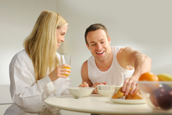 Couple having breakfast in the morning