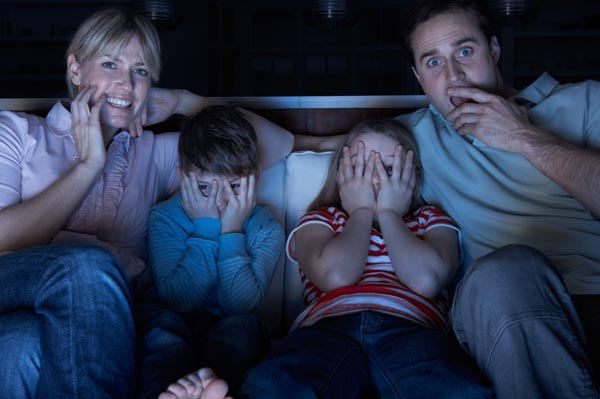 family-watching-scary-halloween-movie