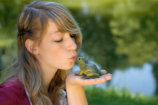 Girl kissing toad
