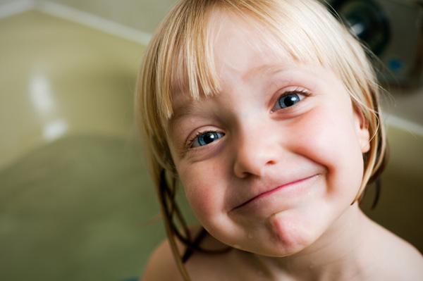 Happy preschooler in tub