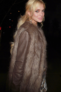 Lindsay Lohan's flashing a brighter smile