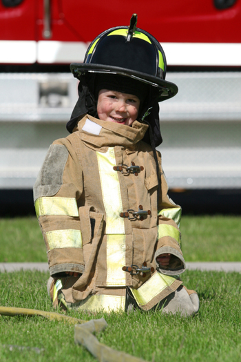 Little boy dressed as firefighter