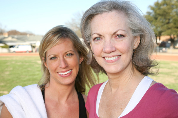 Mature woman and woman in 30s exercising to prevent cancer