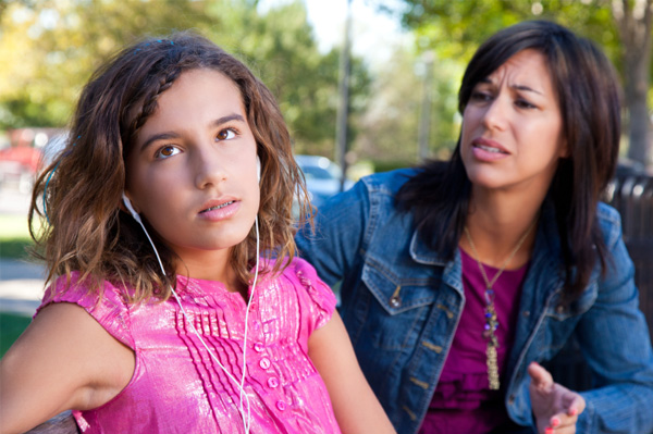 Mom and preteen daughter in conflict