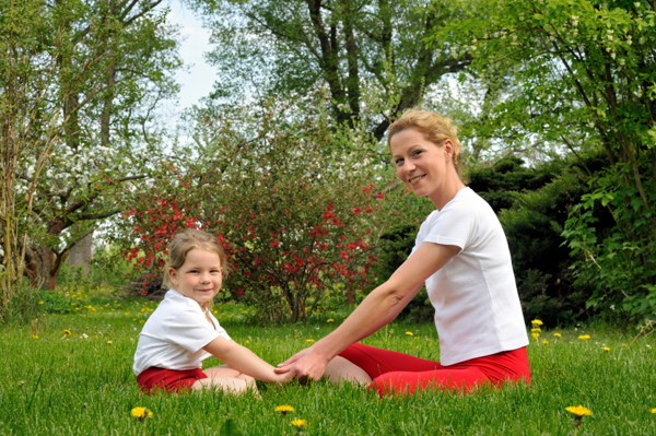 Mom and preschooler doing yoga