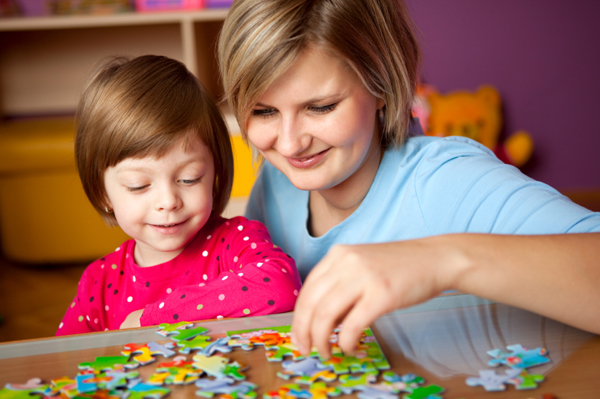 Mom and daughter playing with puzzle