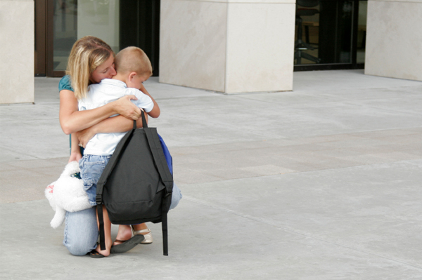 Mom dropping off son at preschool
