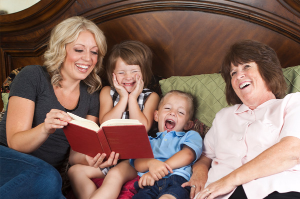 Mom and kids reading a story with grandma