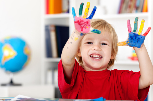 Preschooler painting at home