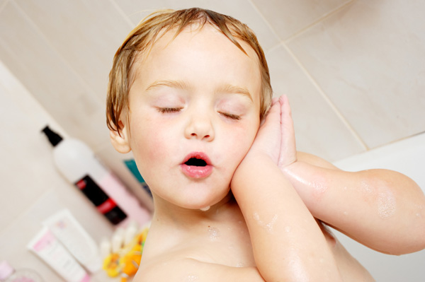 Preschooler taking relaxing bath