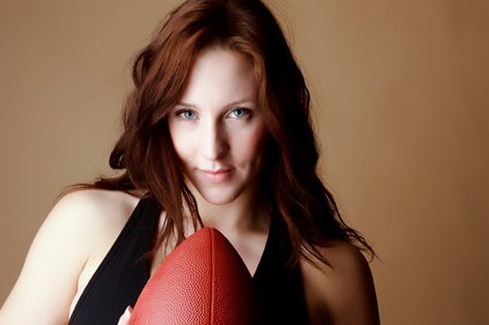 Sexy girl with football