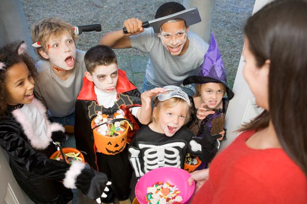 Costumed kids trick or treating