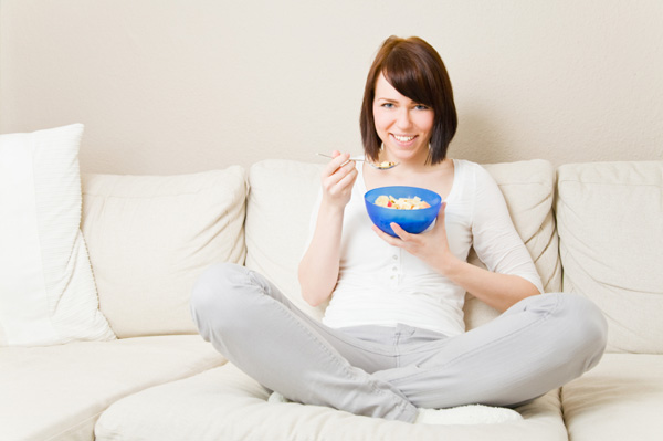 Woman eating cereal with nuts