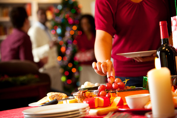 woman eating fruit at holiday party