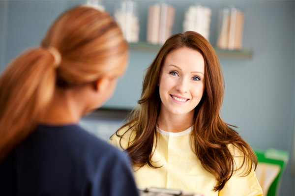 Woman visiting with nurse