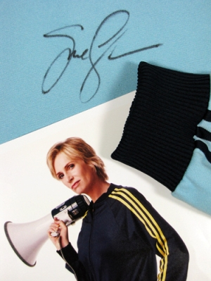 Bid on Sue Sylvester's track suit, signed by Jane Lynch
