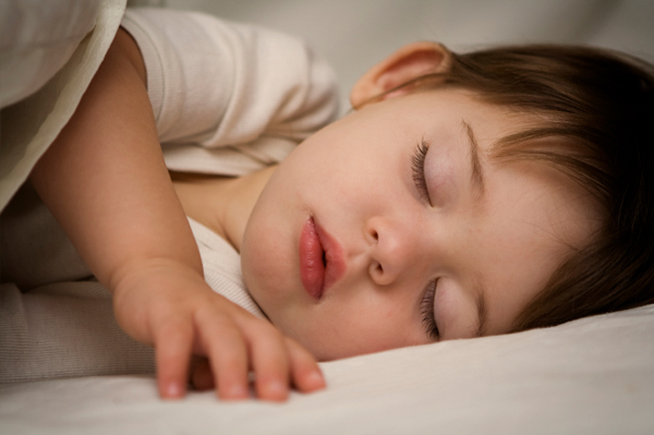 Child sleeping in bed. Child And Family Development Charlotte
