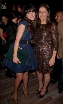 Zooey Deschanel (New Girl) strikes a pose with Mayim Bialik (The Big Bang Theory) at The TV Guide Magazine Hot List Party