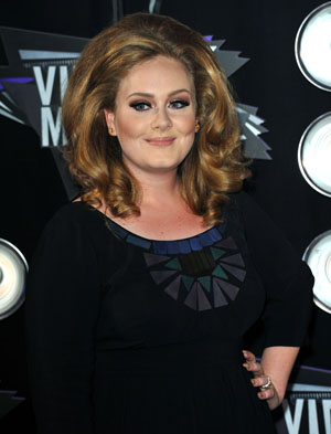 Adele doing well after throat surgery