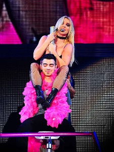 Britney gives a Jonas Bro a risque lap dance