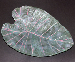 Elephant ear leaf concrete birdbath