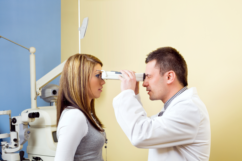 Woman getting her eyes checked for chronic diseases like diabetes