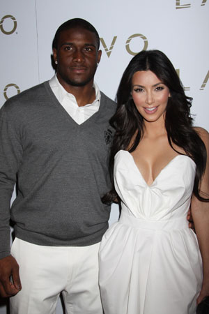 Kim Kardashian in love with Reggie Bush?