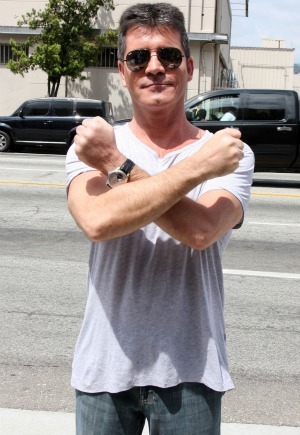 cowell joins twitter nation!