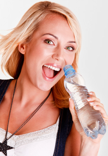 Woman drinking water on Black Friday