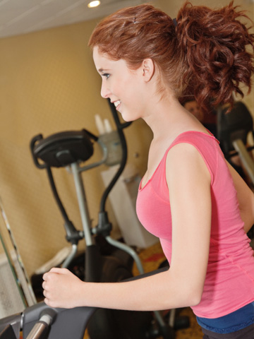 Woman exercising in hotel gym