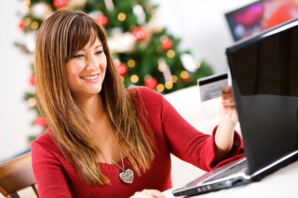 Woman shopping online for Christmas gifts