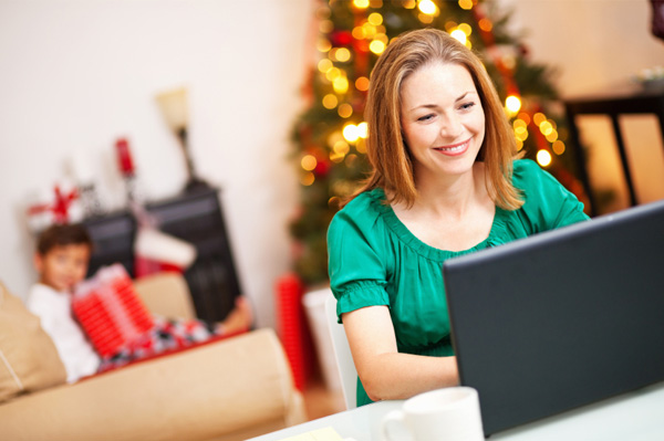 Woman doing Christmas shopping online