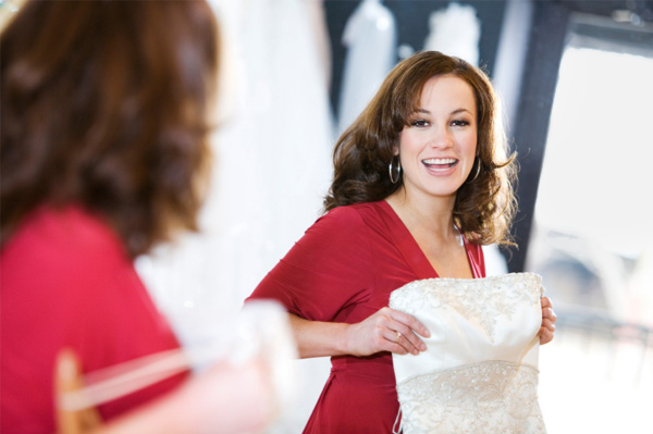 Woman at bridal salon with a wedding dress