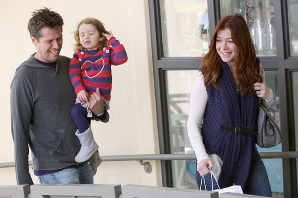 Pregnant Alyson Hannigan, husband and daughter