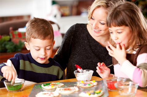 Mom making Christmas cookies with kids