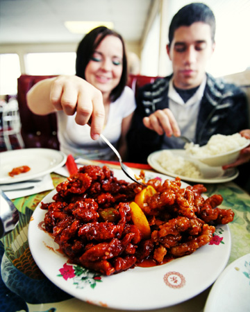 Couple having Chinese food on Christmas