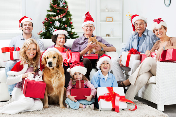 Family celebrating Christmas with dogs